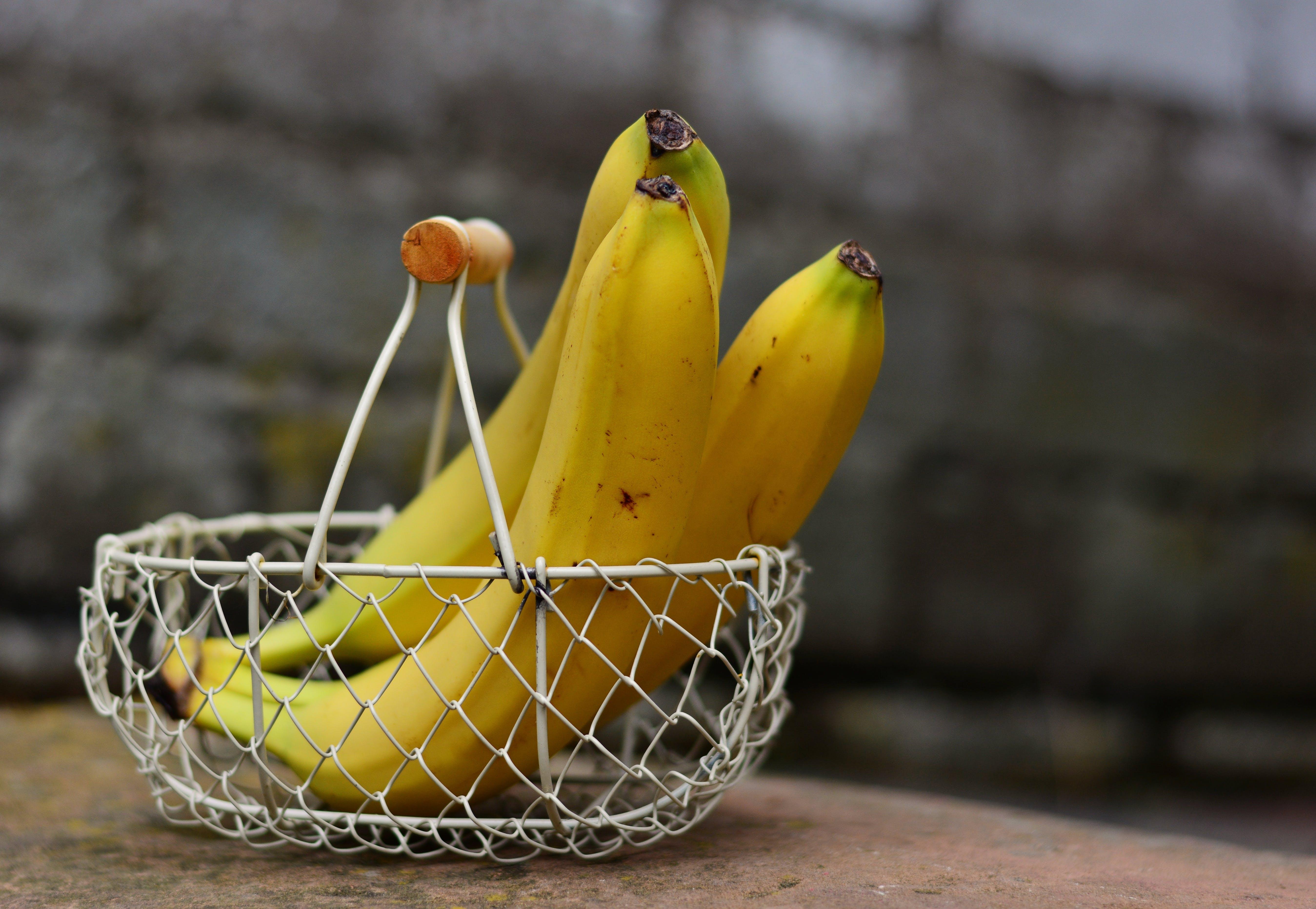 Three Banana on Gray Wire Basket
