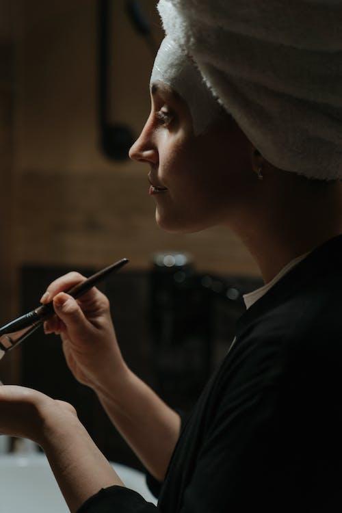 Woman in Black Shirt Holding Pen