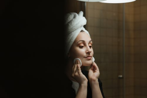 Woman in White Towel Covering Her Face