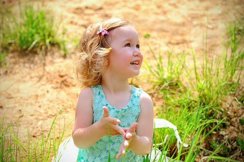 Happy little girl playing in nature