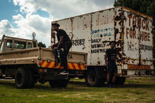 Black men and freight rusty transport