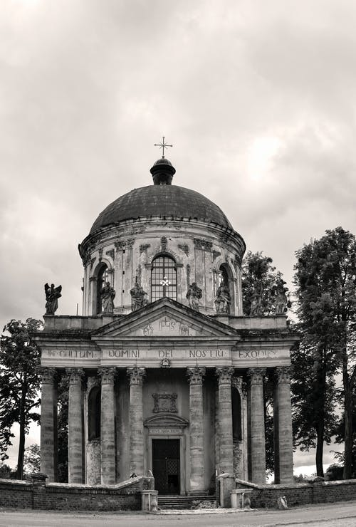 Old stone church under gloomy sky
