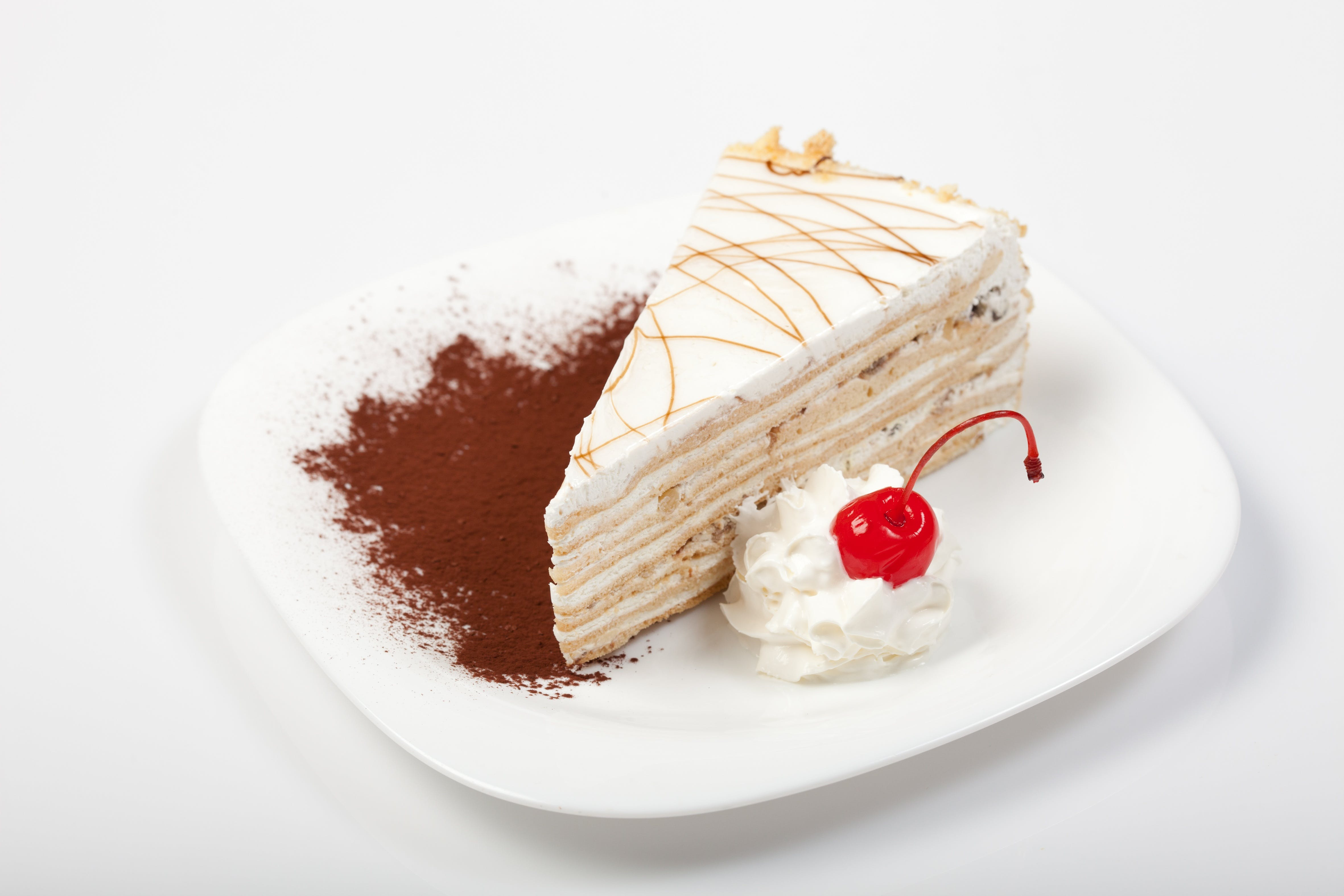 Slice of White Icing-covered Cake on Plate