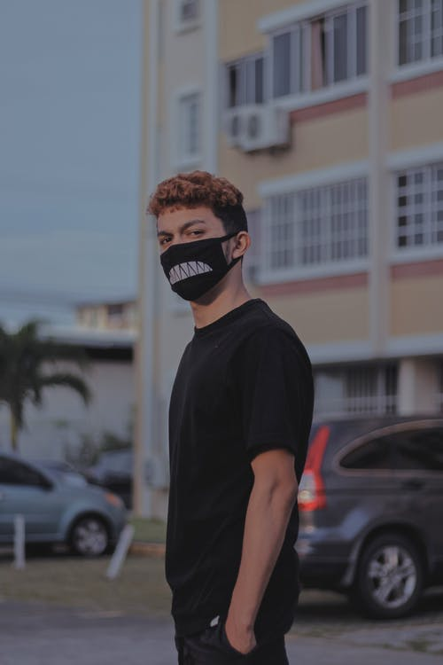 Young man in mask on street