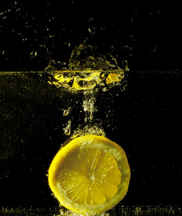 Yellow Lime Submerged in Water