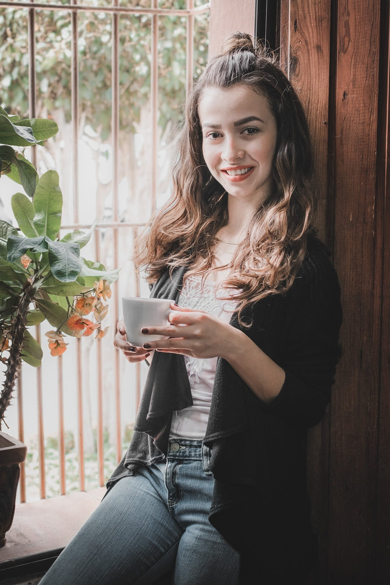Woman Near Window Holding Cup of Coffee