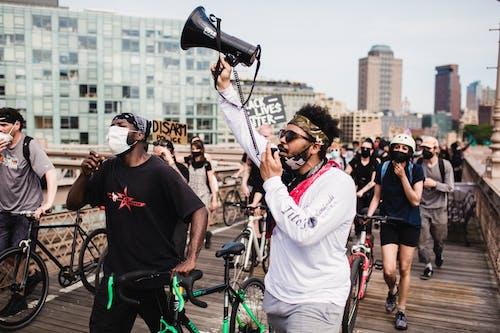 Photos gratuites de activisme, activistes, bicyclette, blm