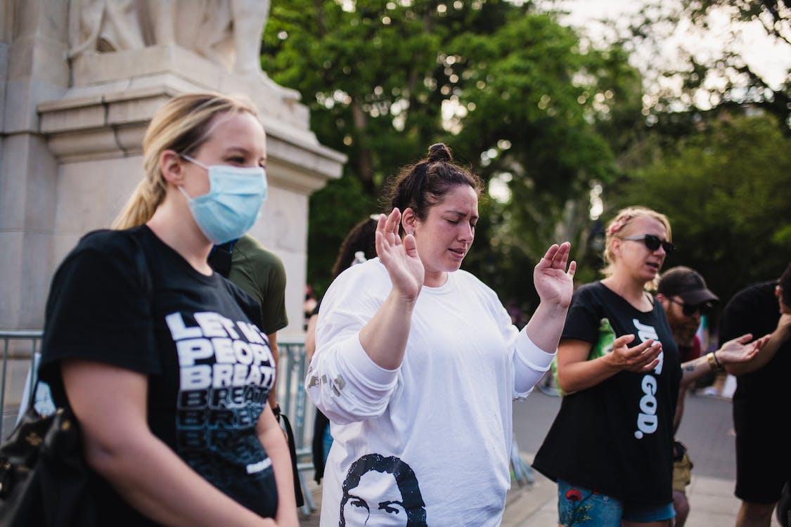 Women Praying Outside