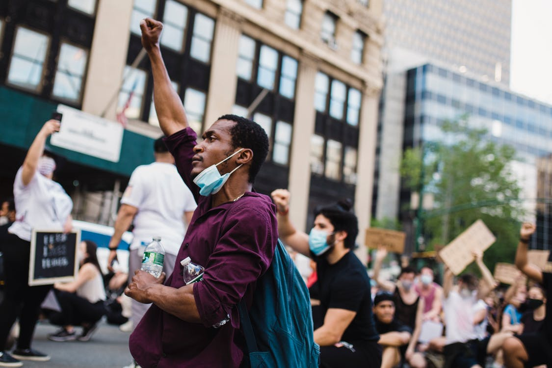 Man With Raised Fist in a Protest