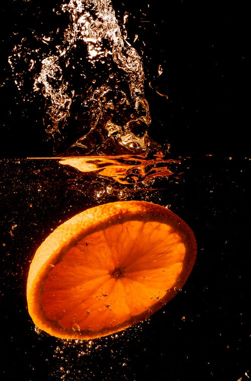 Sliced Orange Submerged in Water