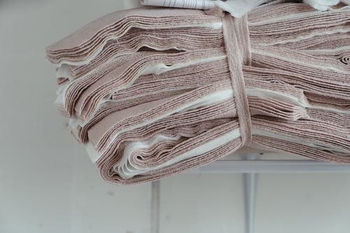 White and Pink Striped Textile