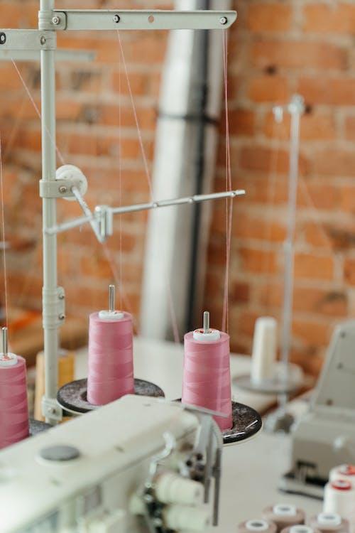 Pink Pillar Candles on White Metal Rack