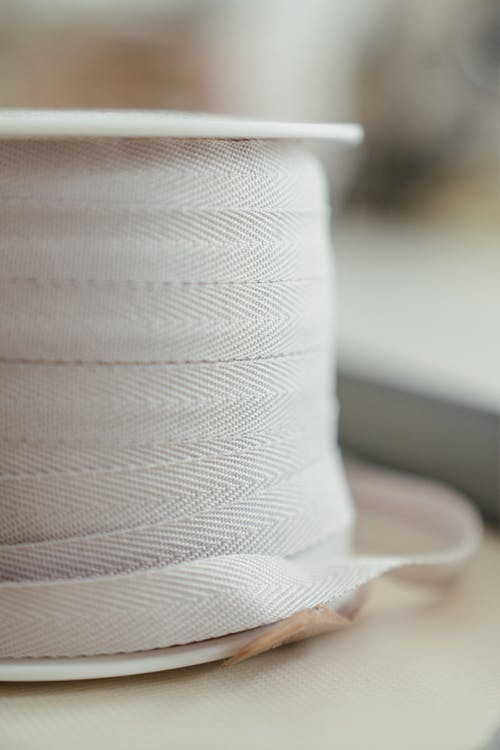 White Rolled Paper on Brown Hat