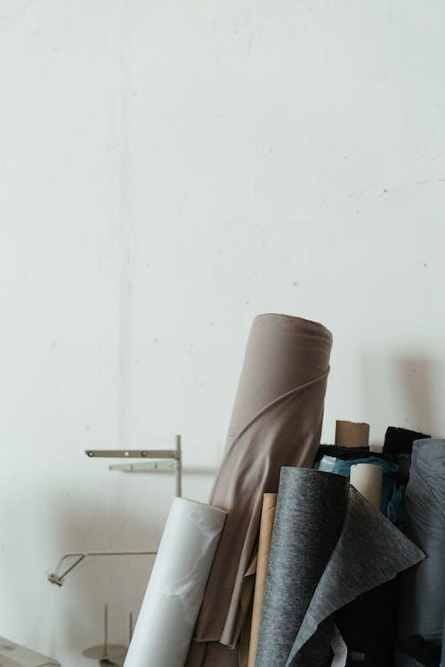 Brown Leather Sofa Chair Near White Wall