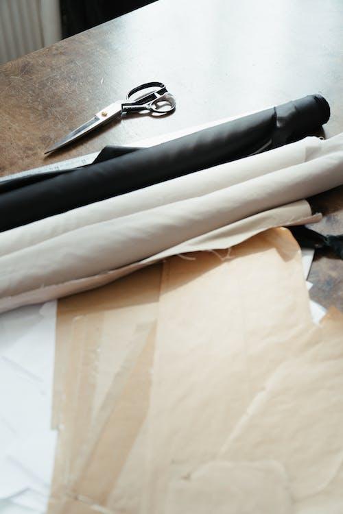 Black and Silver Scissors on White Textile