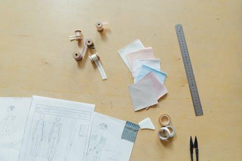 White Printer Paper Beside Scissors and Scissors
