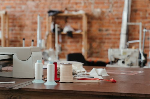 White Plastic Cups on Brown Wooden Table