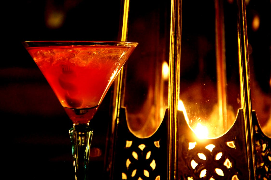 Cocktail Glass Near Candle Holder