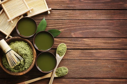 Bowl of Green Powder on Brown Wooden Surface, healthy skin tips for face, how to get healthy skin on face, healthy skin diet, foods for healthy skin and hair, how to get healthy skin in a week, fruits for healthy skin, how to get healthy glowing skin, healthy skin definition,