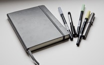 notebook, pens, blur