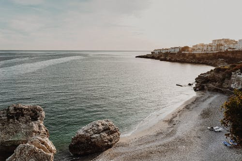 Peaceful rocky coastline with cliffs and big stones