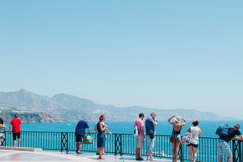 Group of tourists enjoying view of sea