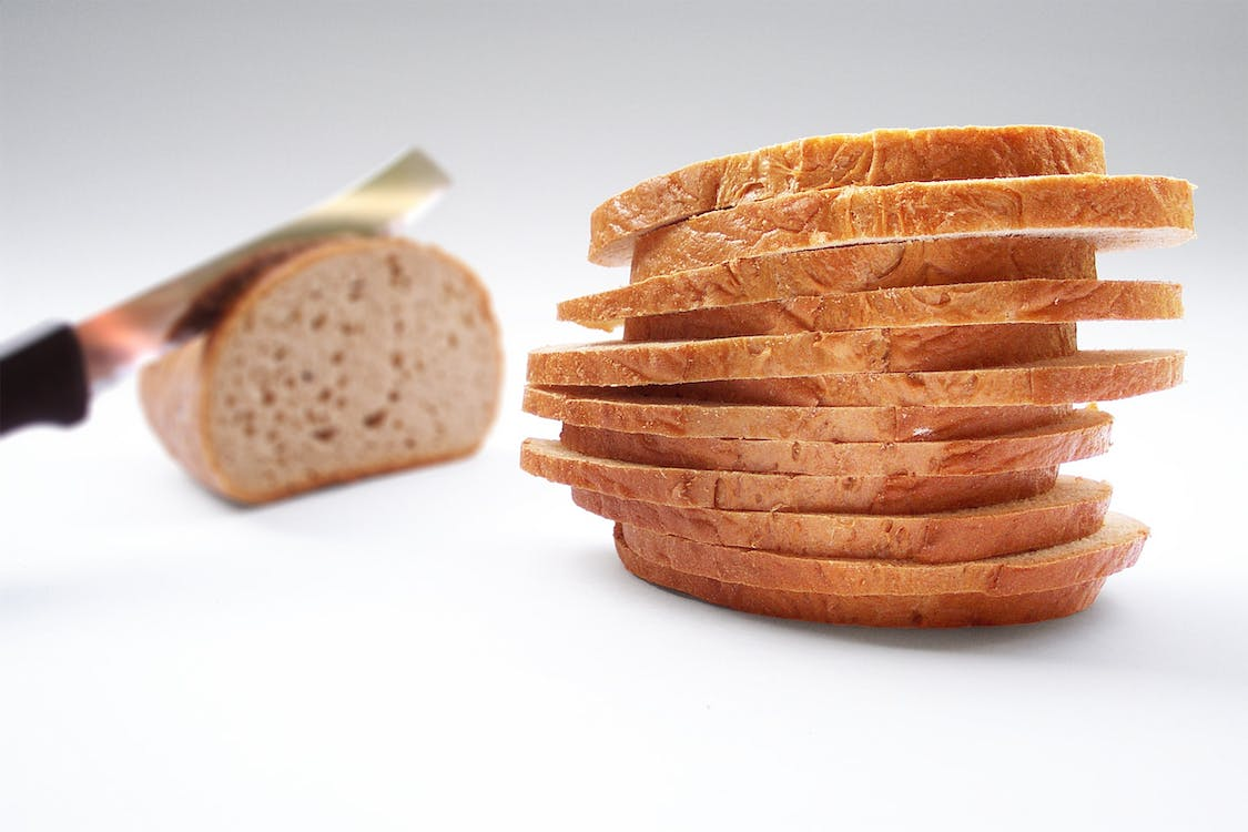 Stack of Wheat Sliced Bread on Top of White Surface