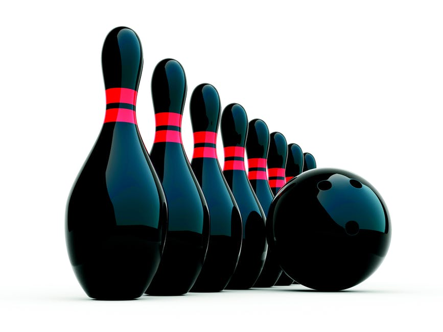 Lined Up Black Bowling Pins Beside Bowling Ball