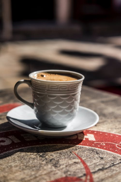 Ceramic cup of espresso on wooden table
