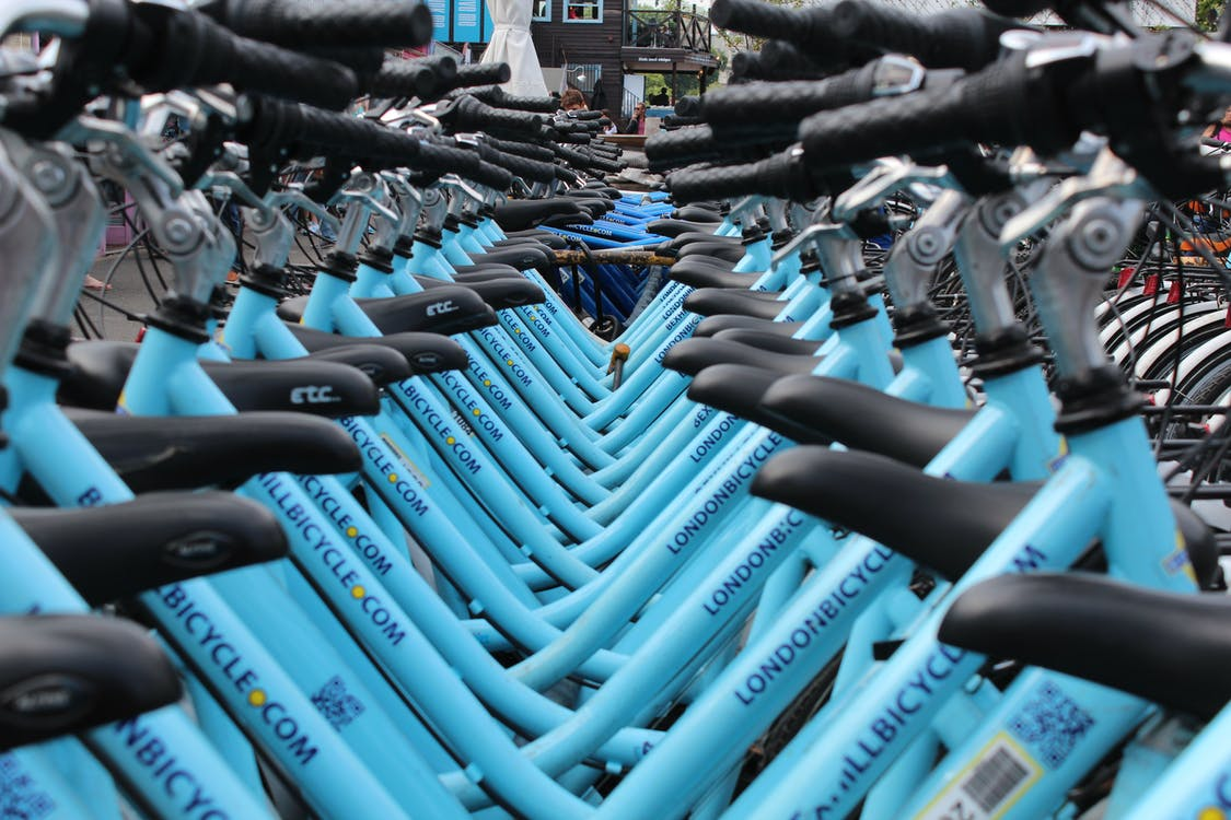 Row of Blue Cruiser Bikes
