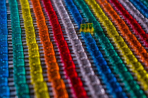 Rows of multicolored car electrical fuses