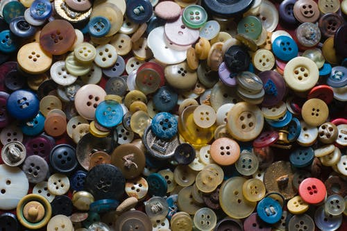 Pile of different multicolored clothing buttons