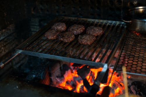 Grilling meat cutlets on barbecue grate