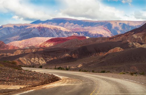 Narrow road in spectacular mountainous terrain on sunny day