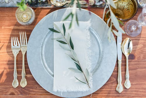 White and Green Leaf Decoration On Round Plate