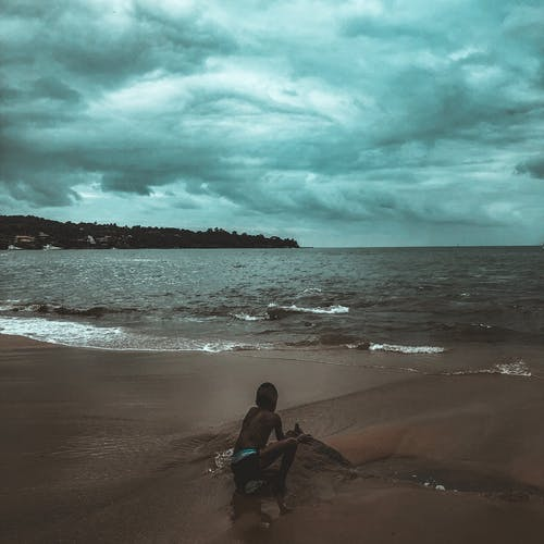 Photo Of Boy On Seashore
