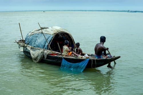 Poor black children on fishing boat