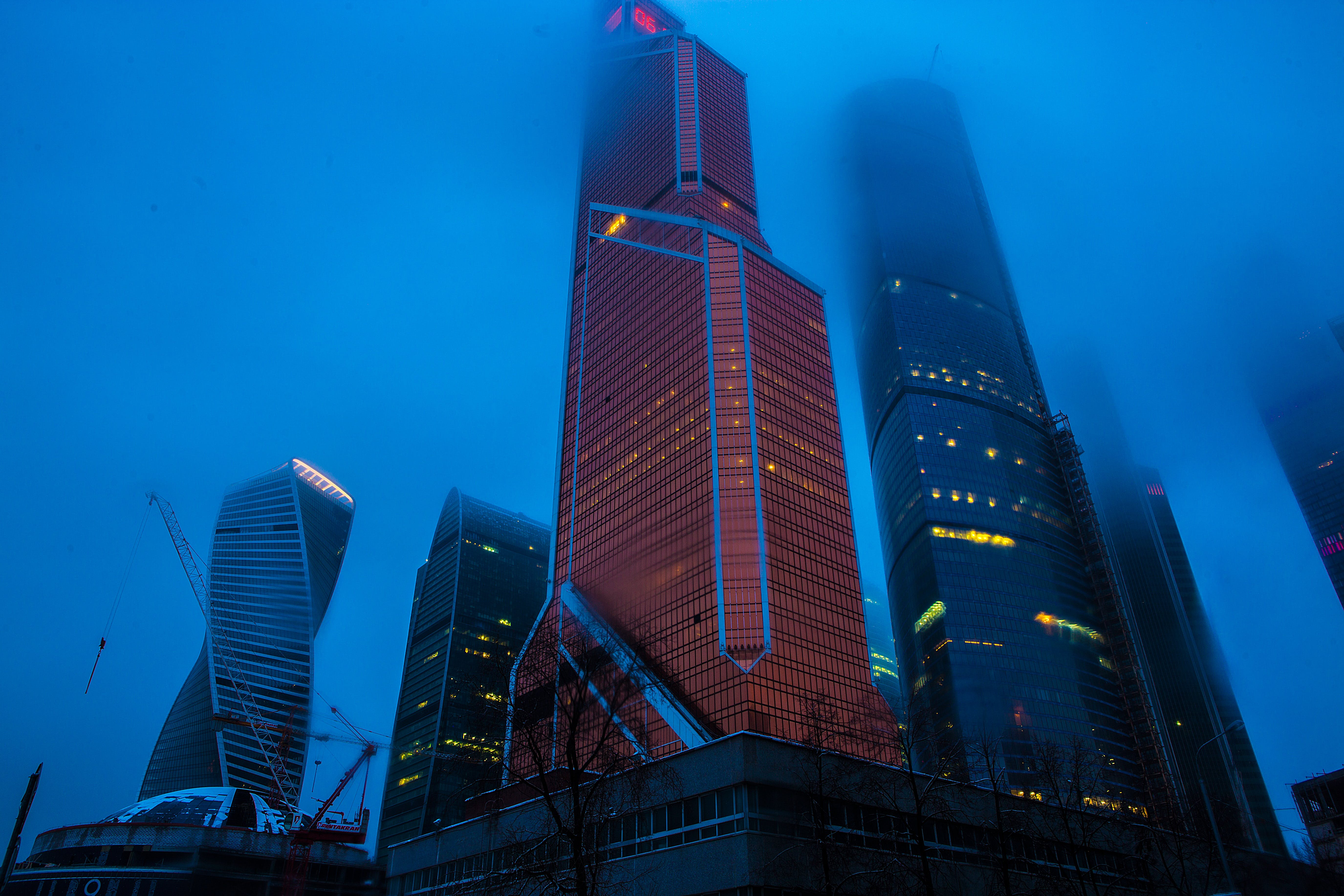 Low Angle Photography of High Rise Buildings Covered With Fogs