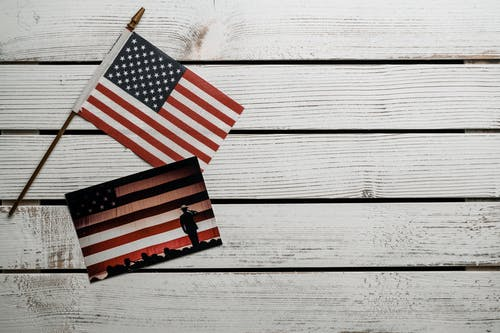 American Flag on White Wooden Wall
