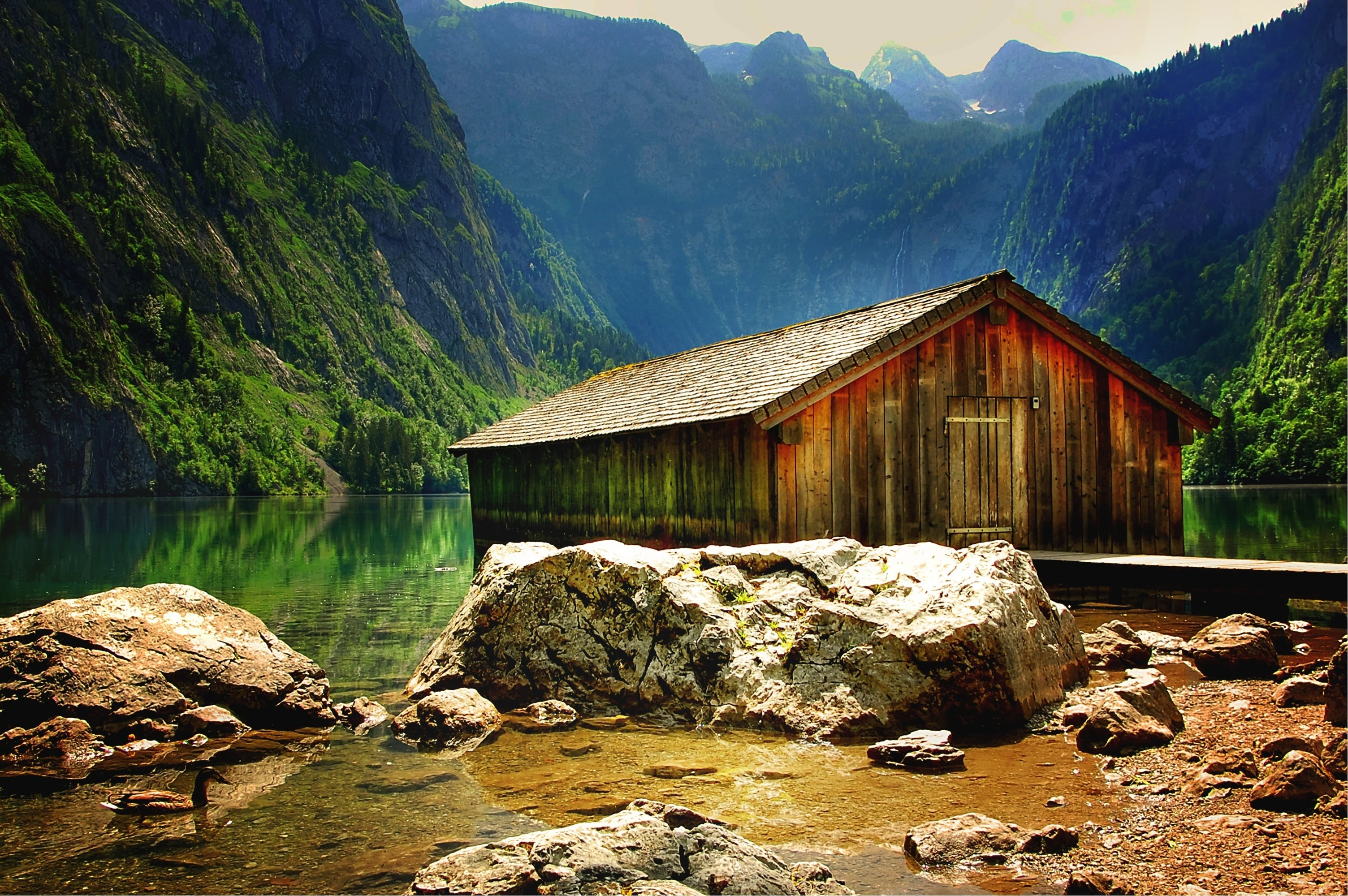 Brown Wooden House Near at Body of Water