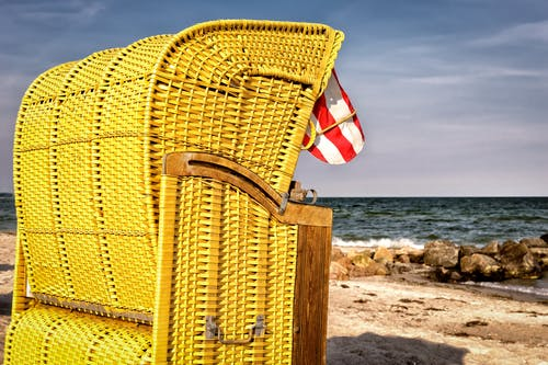 Brown Wicker Basket Near Seashore
