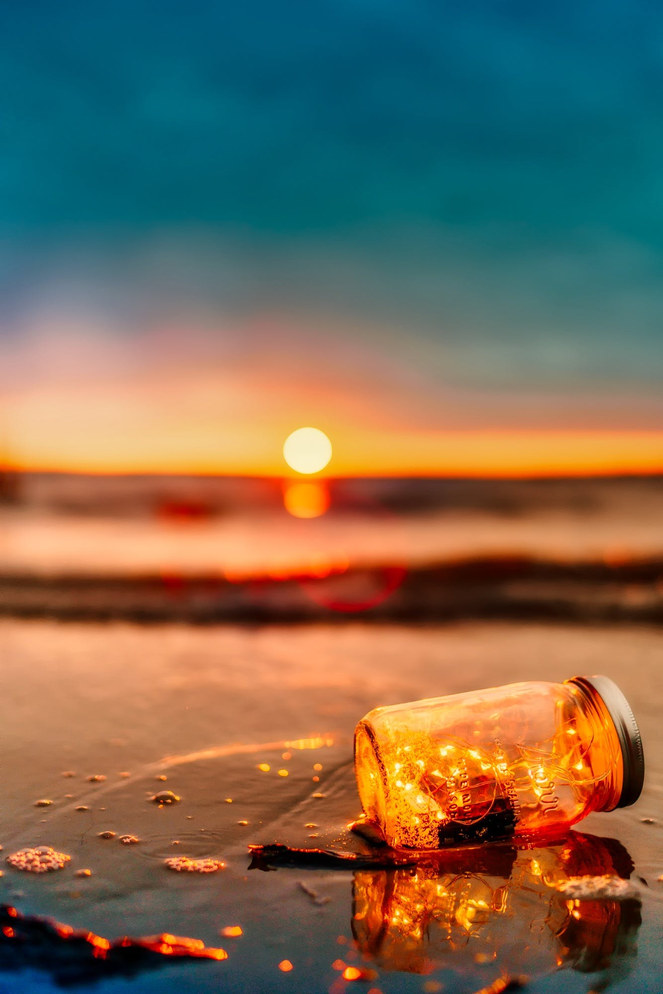 Orange Mason Jar in Body of Water