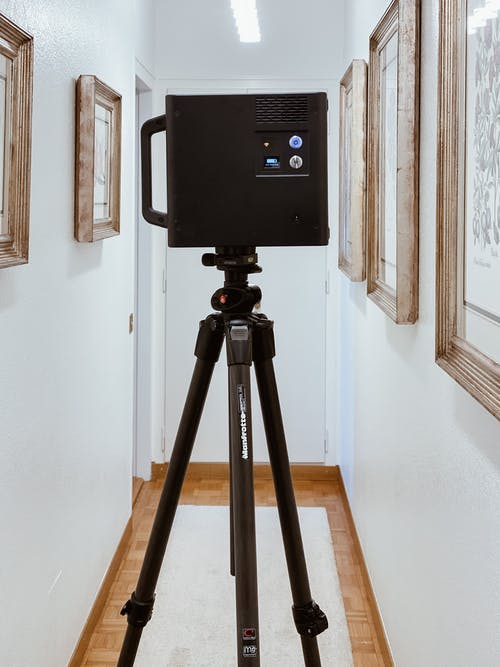 Black Camera on Tripod Stand
