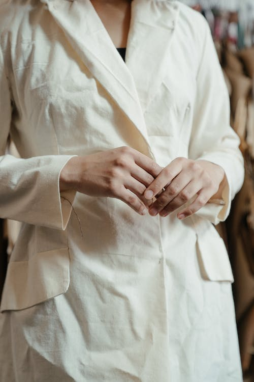 Man in White Dress Shirt Holding Hands With Woman in White Dress Shirt