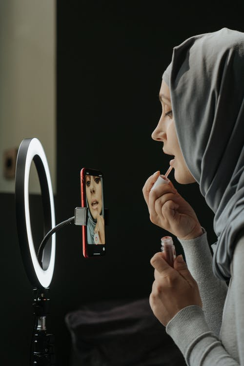 Woman in Gray Hijab Holding Iphone