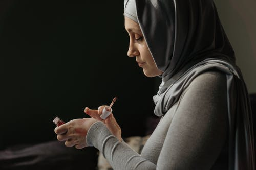 Woman in Gray Hijab Holding Smartphone
