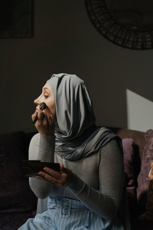 Woman in Gray Hijab Holding Black Tablet Computer