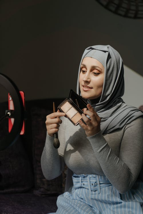 Woman in Gray Hijab Holding Black and White Ceramic Mug