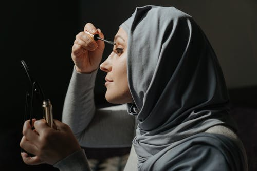 Woman in Gray Hijab Holding Pen