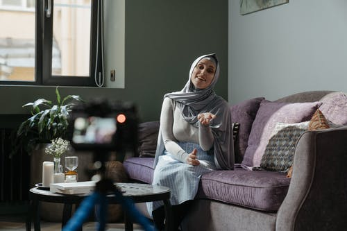 Woman in Gray Hijab Holding Clear Glass Mug